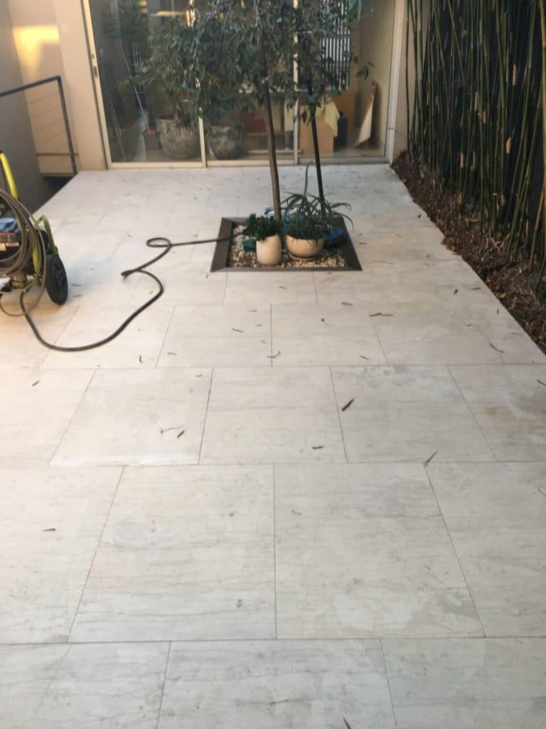 Limestone courtyard stripping and sealing