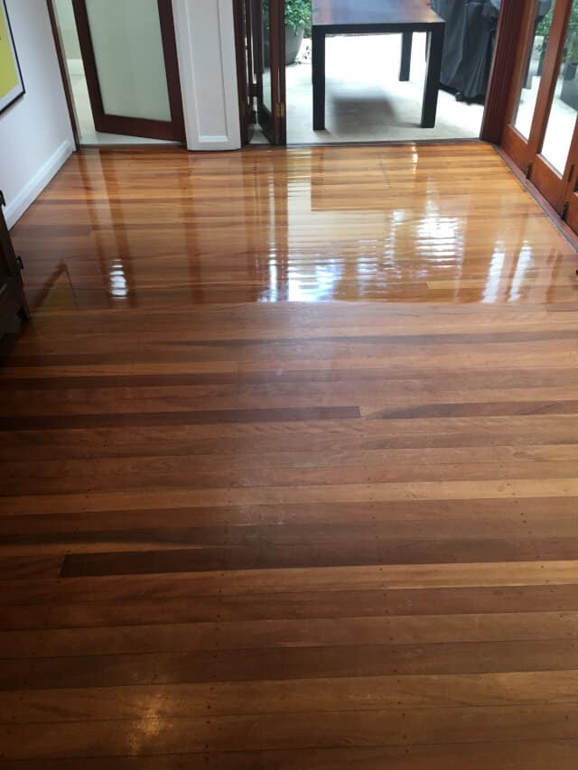 enterance wood waxing and buffing before