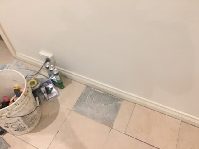 before ceramic tile repair lounge room