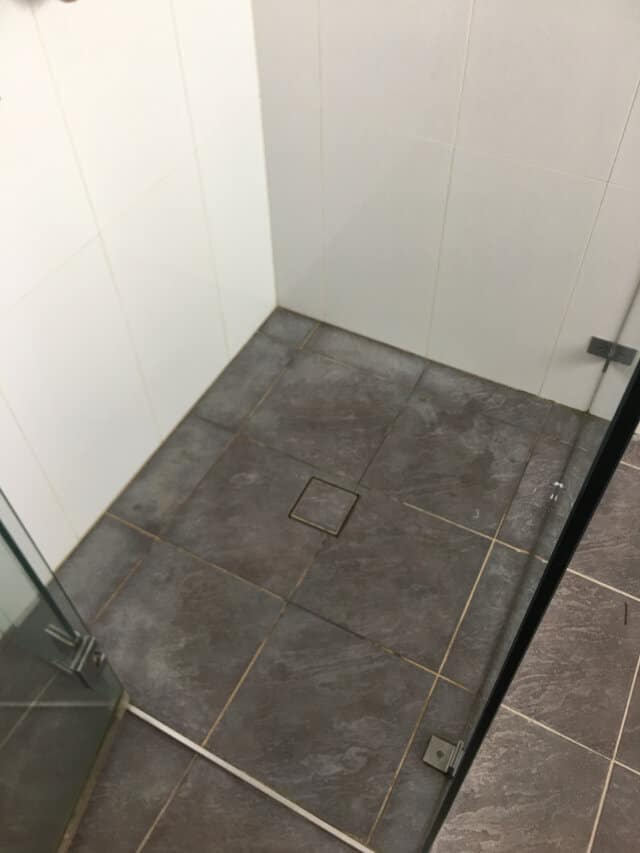 before shower base regrout ceramic