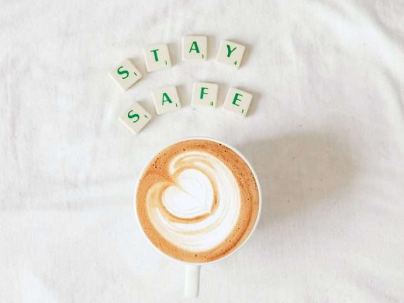 flatlay coffee cup and scrabble letters spelling stay safe